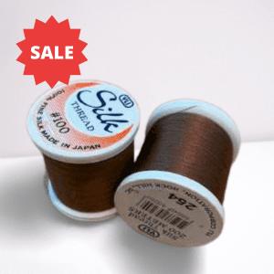 col 254/223 brown silk thread x 2